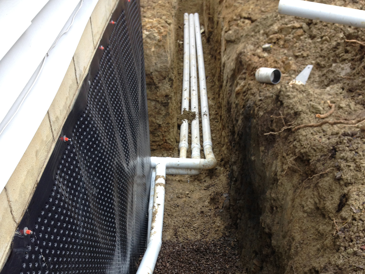 Champion Services Footer Drain Replacement